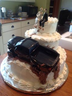Truck struck in mud wedding cake