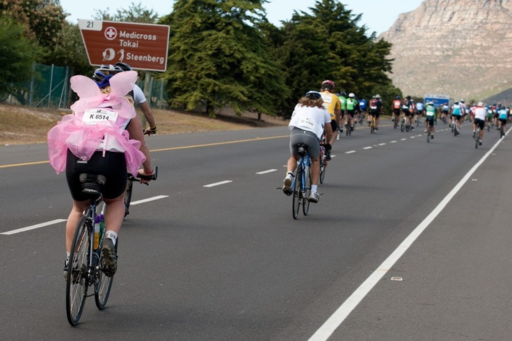 A cyclist competes in the race while kitted out in a pink fairy costume