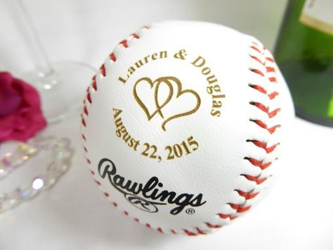 An engraved baseball makes an awesome guest book alternative for the baseball-lovin' couple! You'll probably need more than one, depending on the size of your guest list.