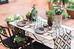 This elegant outdoor inspiration shoot features the perfect mix of sweetness (that adorable dress!), rusticity (that yummy tablescape!), and local flair (those gorgeous tiles!) that makes for an unforgettable shoot. PhotographerAmy Fanton(who's married to an Argentinian herself!) capturedthe old world charm of Buenos