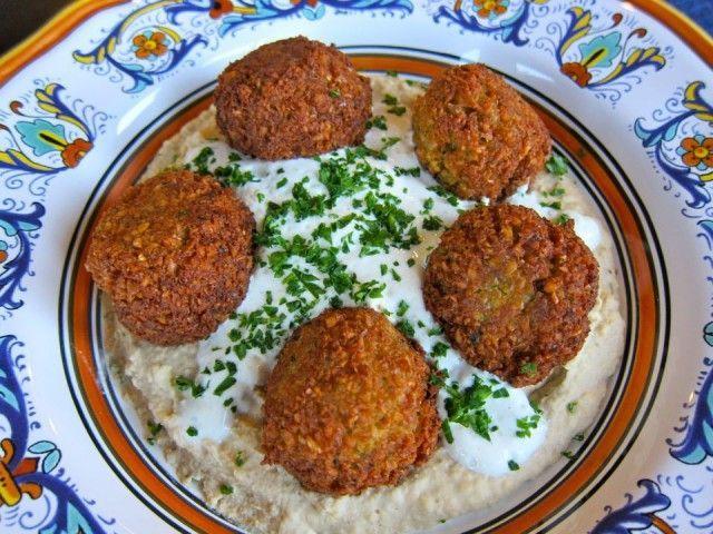 Falafel. Made with chickpeas, onion, parsley, garlic, flour, salt, cumin, coriander, pepper, cayenne, cardamom, and vegetable oil.