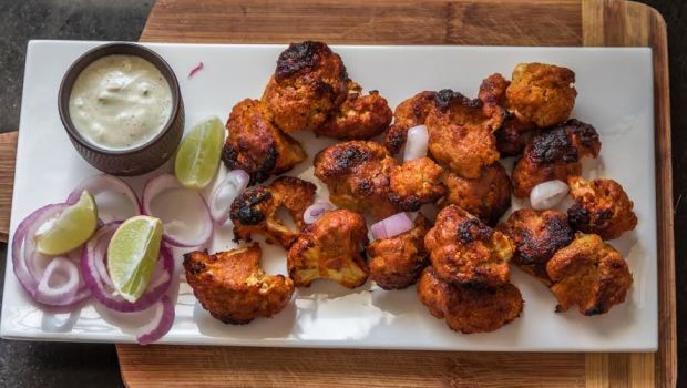 Tandoori Gobhi Recipe - Cauliflower florets marinated in a variety of spices and grilled on a tandoor/oven.