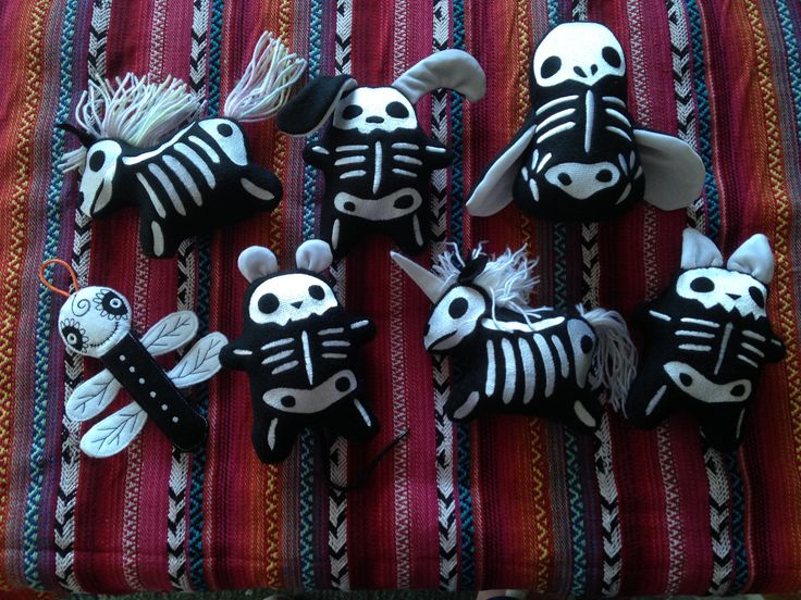 "Skeleton toys. Skelanimals and a doodle bug. Machine embroidered plushies made with patterns from ""Urban Threads"""