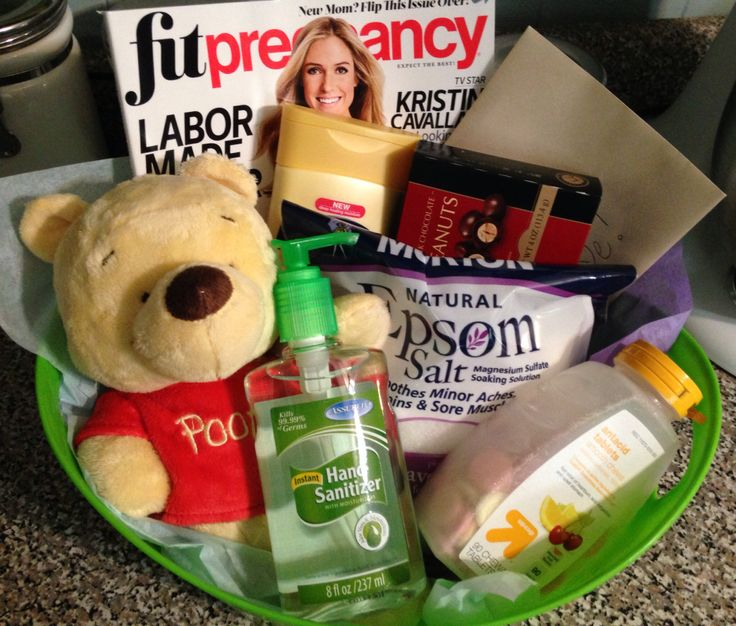Pregnancy gift basket: magazine, lotion, chocolate, Epsom salt, tums, moisturizing hand sanitizer, baby's first stuffed animal, congratulations card.
