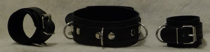 Dark leather shackles and collar