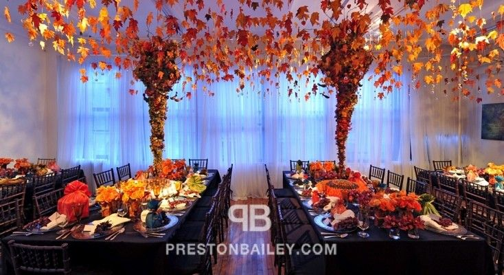 candles centerpiece dining entertaining holiday inspirations indoor leaves long table table setting tall centerpiece thanksgiving color|brow...