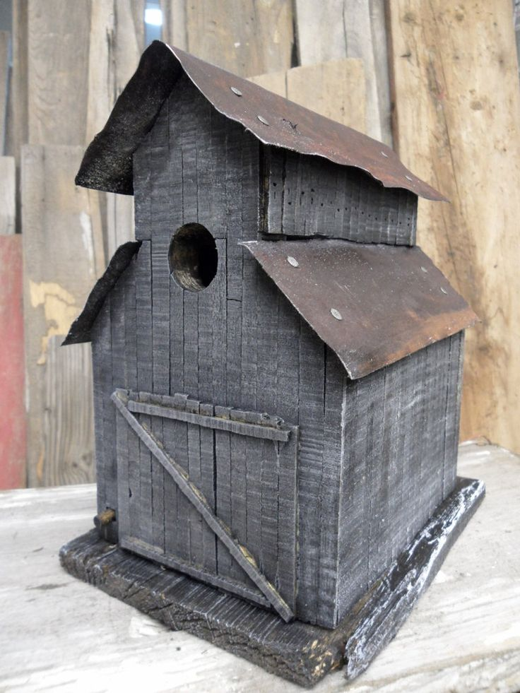 Barn birdhouse. Made like an old stable. Rustic look and antique looking tin roof.
