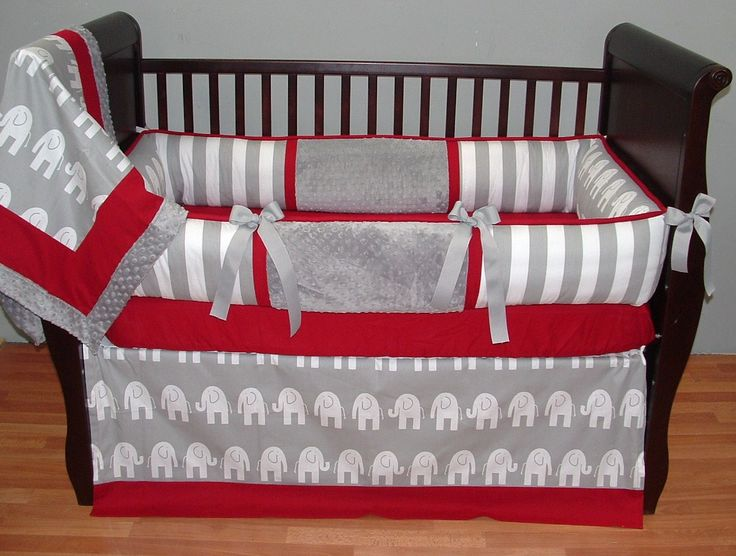 Hunter Baby Bedding  This custom 3 pc baby crib bedding set includes a modern plush bumper pad, tailored crib skirt, and so soft minky edged and backed blanket.  The modern gray and white stripes and elephants, red piping and trim, gray grosgrain ties, and ultra soft gray minky combine softness and textured detail. Top quality and a modern touch for your little angel's nursery.