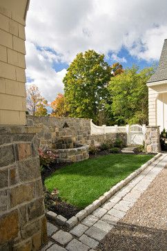 cobble and fountain integration into stone wall, wood pickets add softness
