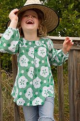 Want to be cool, comfortable and looking gorgeous?  Parasol Green top with pretty front inverted pleat is great for covering up in the sun and helping to protect precious skin. Cool, comfortable, lightweight cotton girls top sizes 1-12 years. Designed in Australia, soft, high quality fabric made exclusively for Three Sun Possums