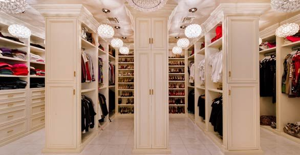 Dr. Phil's House --  His/Her closet is part of the master bedroom suite, which also includes his and hers bathrooms.