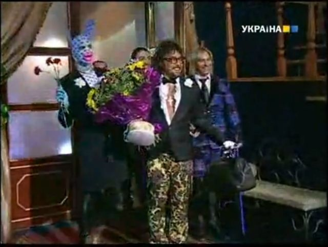"""Verka Serduchka - A clip from his talk show """"Spalny Vagon"""" aka """"SV-show"""". The song starts at 00:58. See """"me"""", one of the back-up dancers! :-D Seriously, of course I know Verka and his """"mama"""", but I would love to know who the rest of these people are. Who is this rabbit, whose face I've been using? And what a cool song!  Who are you, red-booted man?"""