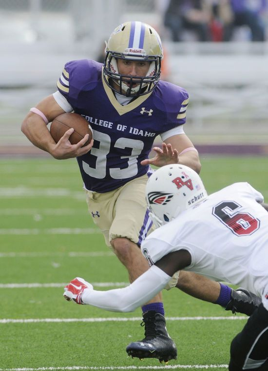 College of Idaho running back Zach Garzoli looks for room to run in an NAIA football game against Southern Oregon Saturday, Oct. 25, 2014 at Simplot Stadium in Caldwell.