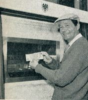 Actor Reg Varney using the world's 1st Automated Teller Machine in Enfield Town, north London on 27 June 1967. Wikipedia