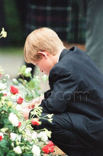 September, 1997.  Poignant image of Harry reading the condolence notes outside Kensington Palace.
