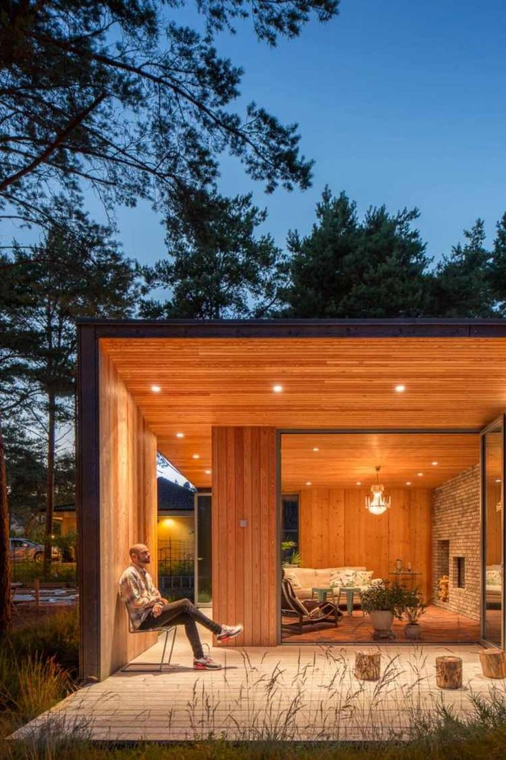 covered terrace, exterior wood siding and matching chair design
