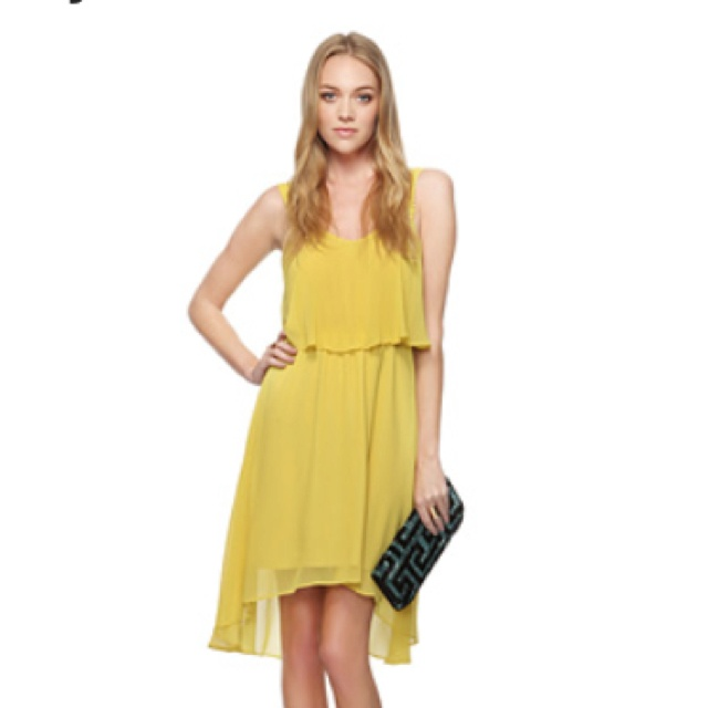 Love the dress and the clutch. Forever 21.