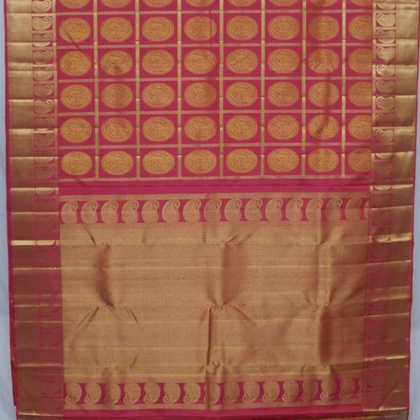 Light fuchsia pink silk comes alive with large gold checks, and golden yellow elephant motifs nestled in each check. Large gold ambis sit atop the gold border.