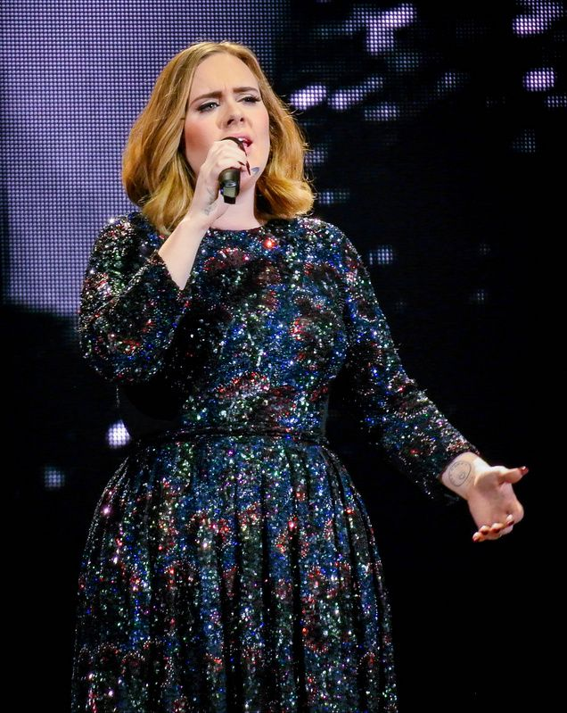 Adele screens football match during gig