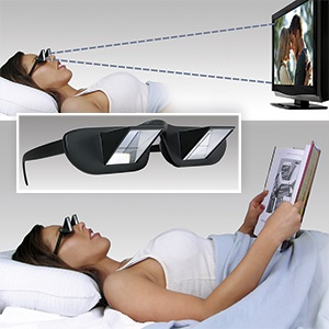 """Prism Bed Specs.  Now you can watch TV or read while lying flat in bed.""""Avoids neck cramps & eye strain.The Prism Glasses turn your view to a downward 90 degree angle, eliminating the need for head movement.Perfect for people with limited mobility. Lie on your back with your head on a pillow, and you'll be able to read a book resting on your chest."""