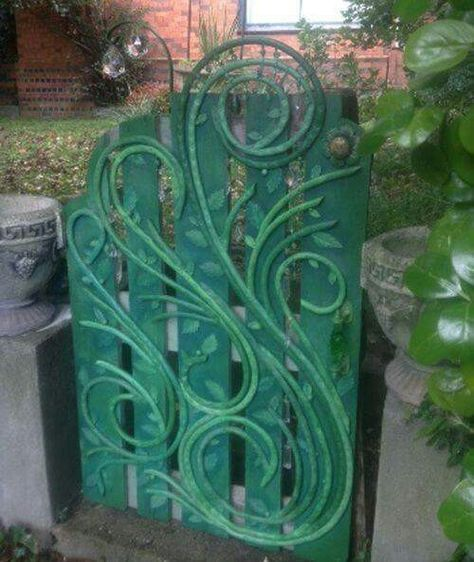 So cute. Garden gate decorated with old garden hose Via Re scape.com