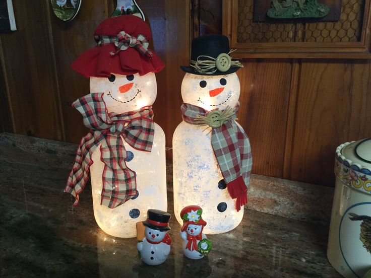 I made these snowmen out of large pickle jars and light globes.                                                                                                                                                                                 More