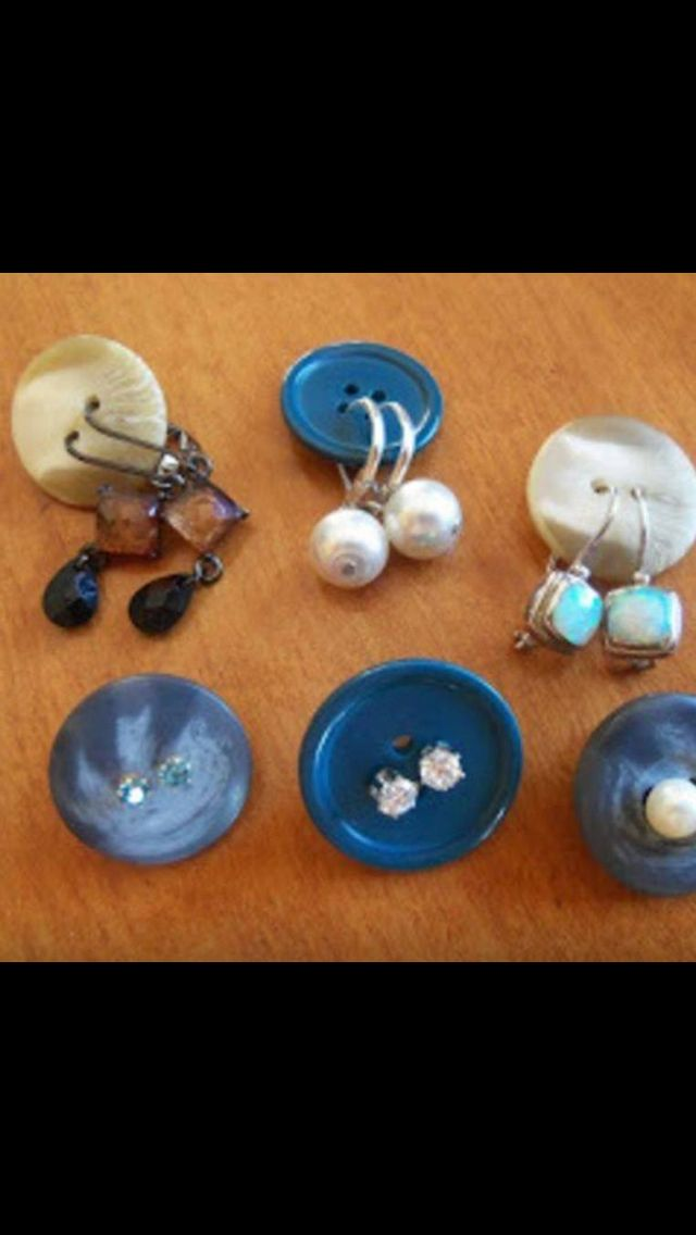 Button Earring Holders...such a great idea as long as you dont lose any buttons. lol.