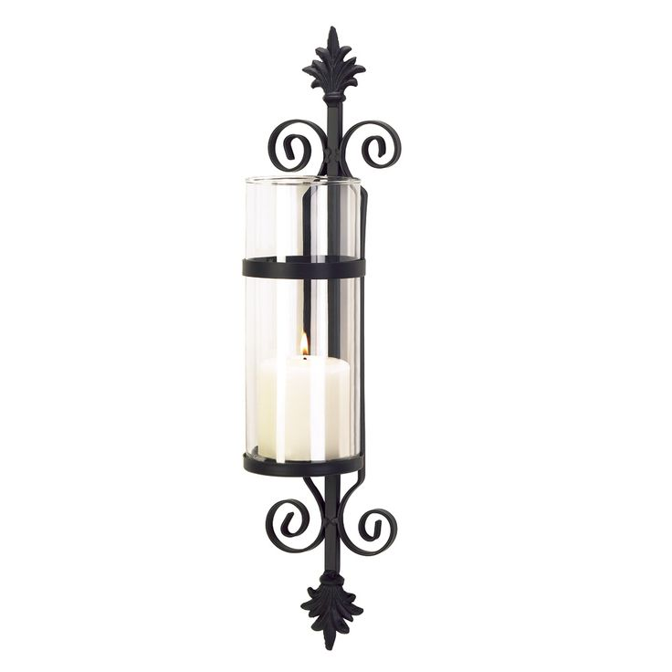 """A palatial touch of Tuscan elegance adds old-world beauty to your home! Ornate matte-black metalwork forms a dramatic backdrop for a crystal-clear cylinder of glass. Simply add your favorite color pillar candle for instant decorating magic!  4¼"""" x 4½"""" x 19¾"""" high.  Metal with glass."""
