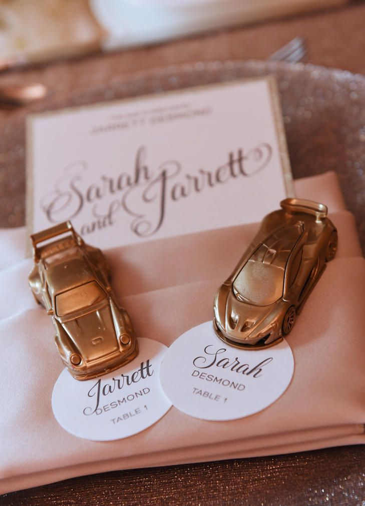Since the groom was a car lover, the couple gave out gold matchbox cars as the escort cards.