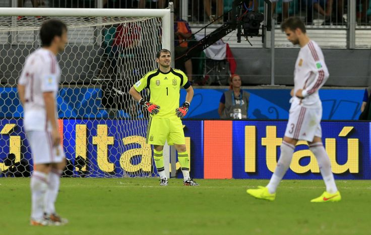 Spain's goalkeeper Iker Casillas, centre, reacts after the 5th Dutch goal during the group B World Cup soccer match between Spain and the Netherlands at the Arena Ponte Nova in Salvador, Brazil, Friday, June 13, 2014.