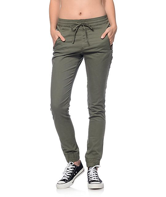 Branch out of the blues, blacks and khakis that are so often what pants are colored. These Jane olive twill zipper joggers by Trillium will add a pop of color while keeping you comfy and moving throughout your day.