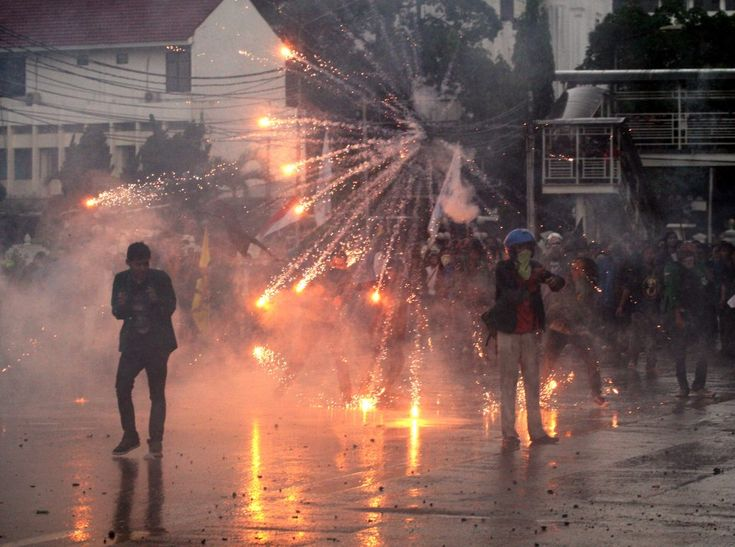 A tear gas canister fired by Indonesian police explodes in the air during a protest against the government's plan to raise fuel prices in Jakarta. (AP)