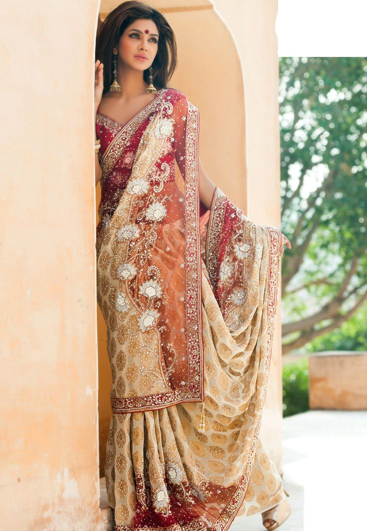 There is no garment more feminine and beautiful than the sari...I wish I had a reason to wear one. <3