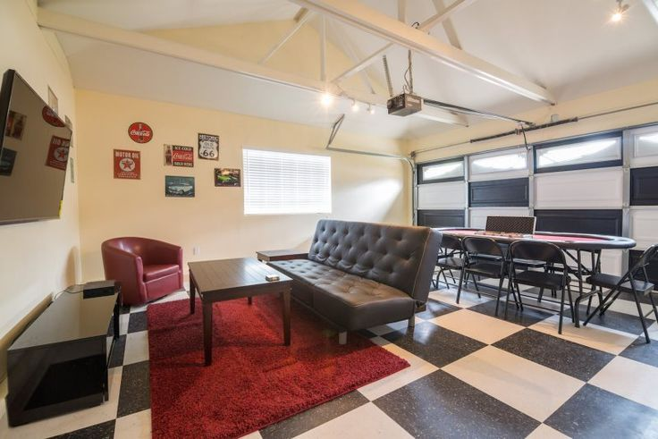 This garage has been converted into a funky game/ movie room. Hang out with the whole gang in this hip hide out in Anaheim California #vacationrental #LunamarVacationHomes #fetchmyvvacay