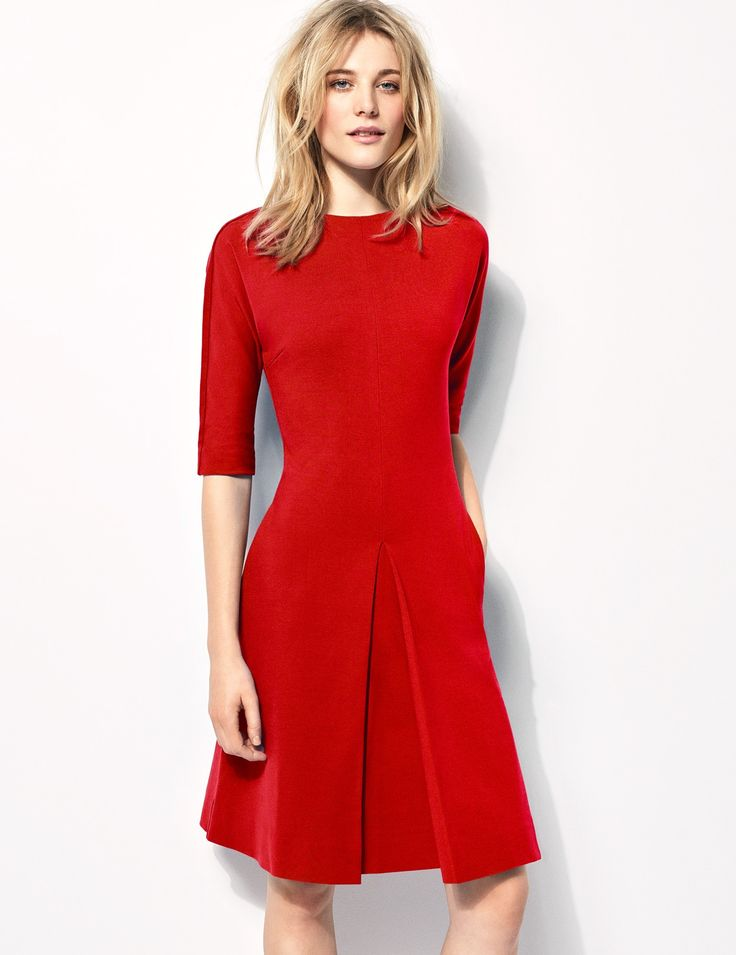 Statement piece of the Miracle Collection, combining the soft, wide neck and  ¾ length sleeve and a flattering a-line skirt with single inverted box pleat. Featuring pockets in the side seams, and a grosgrain covered, centre-back zip, this is the perfect fashion piece that flatters all figures.