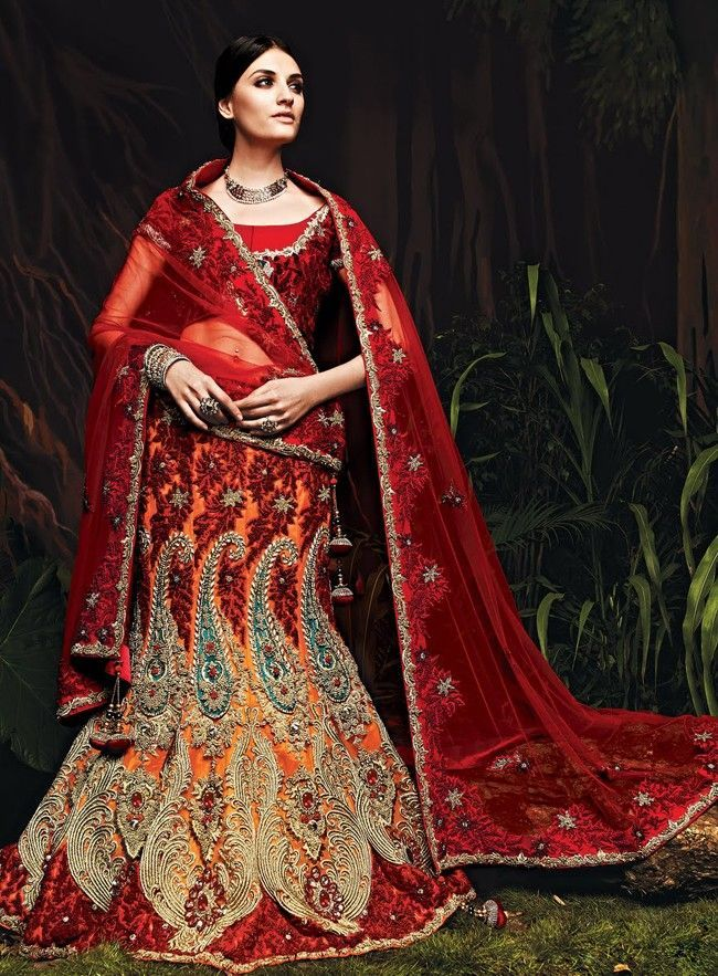 Orange and maroon net lehenga choli, maroon blouse with embroidery patterns and dupatta with self-colored border.