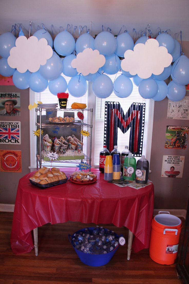 Balloon sky, poster board clouds (covered in spray glitter), hero sandwiches, Magneto's Cheetos, Jugger-knots (Pretzels), Mighty Mac & Cheese and Cap'n America Crunch Bars (rice krispie treats with Cap'n Crunch instead. AMAZING!)