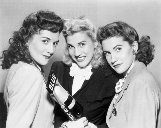 """The Andrews Sisters, (L to R) LaVerne, Patty & Maxene: top-selling swing and boogie-woogie singing group of the 1940s and""""sweethearts of the Armed Forces Radio Service."""" They appeared in 17 Hollywood films, weekly on radio and on endless USO tours during the war."""