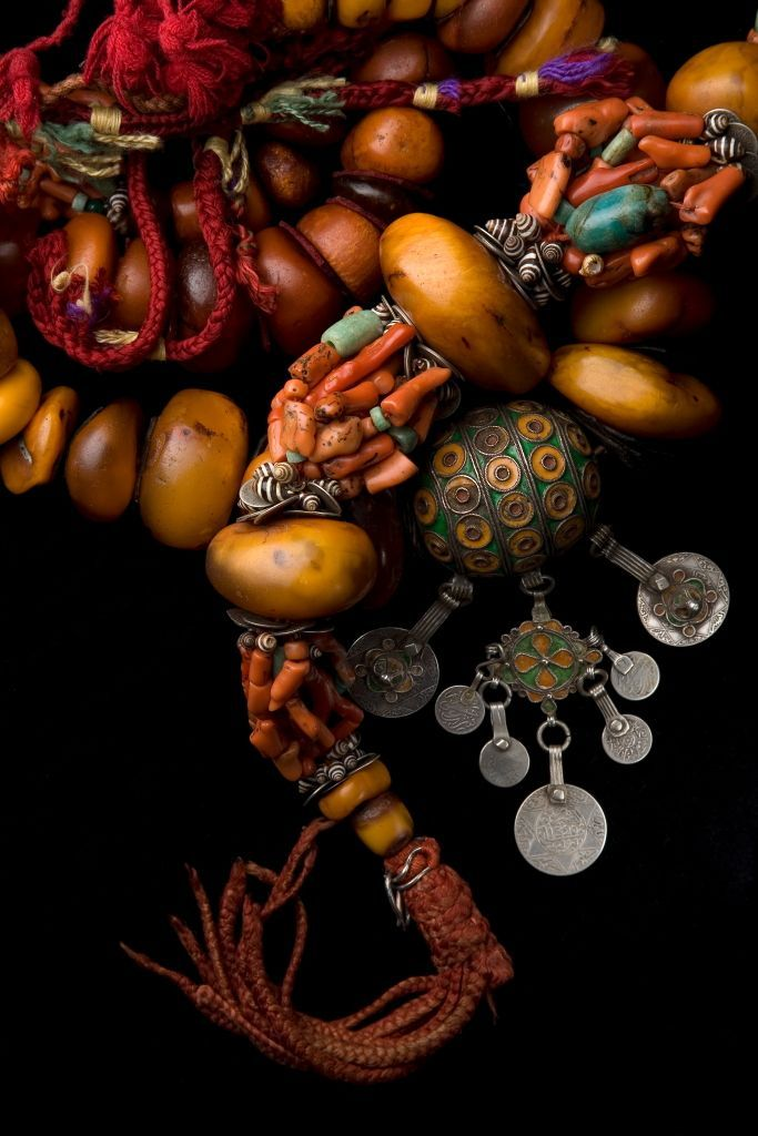 Details from a Moroccan Berber necklace; with enamelled silver, silver, amber, coral, shell, amazonite beads | ©Foundation Pierre Bergé, Yves Saint Laurent