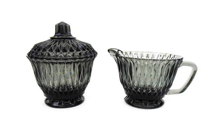 $14.99 - Vintage Libbey of Canada Pressed Glass Sugar Bowl with cover and Creamer in Smoke color, pattern #LRS-45. Unusual and interesting elongated diamond pattern. Produced circa 1950s. Very pretty, hard to find creamer and sugar bowl set. In excellent condition...Please click on the image above for more information or to buy from WileWood. Thank you for your interest.