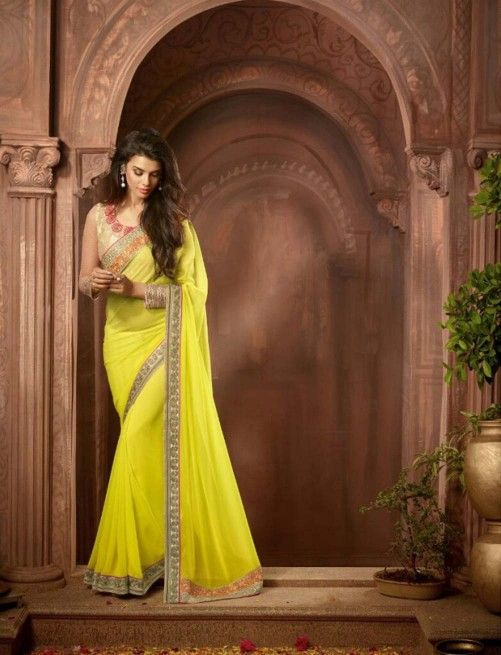 Yellow Designer Poly Georgette Saree & Gold Blouse $60.45 For order whtsap at 9582233490 #yellow #designer #polygeorgette #saree
