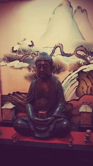 """Budha sculpture in a sushi restaurant """"Satori"""" ... Beautiful!"""