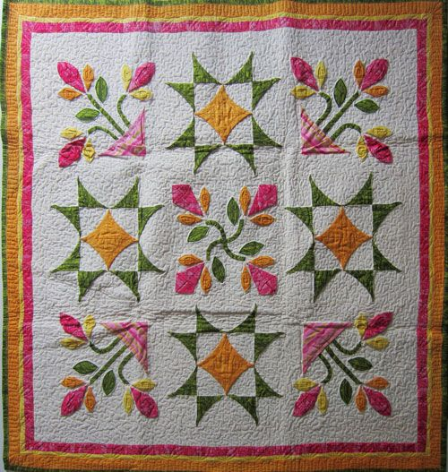 Touch Feely Floral Fabrications (a.k.a. Luscious Lilies - It's Floradorable!), Morning Half Day Saturday, 10/10/2015, 9:00 AM - 12:00 PM at Quiltfest Oasis Palm Springs Totally new textural interpretation of a traditional  patchwork block - it's 3D!  Really easy, fast and template free method - just basic shapes. Contemplate the use of color, form and surface structure. Explore a nifty trick for bias stems and play with dimension - creativity rules OK.