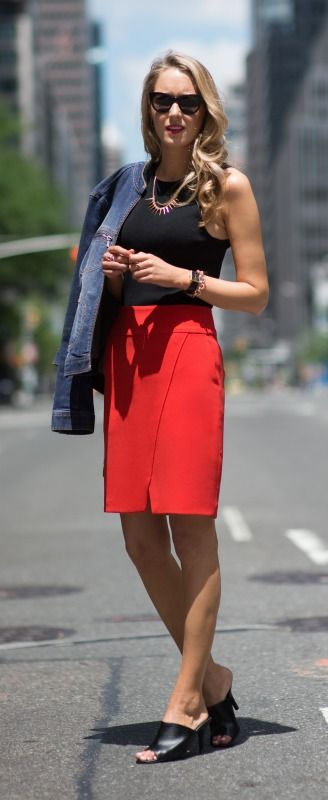 red angled slit pencil skirt, black shell, gold and crystal spike necklace, jean jacket + black mules