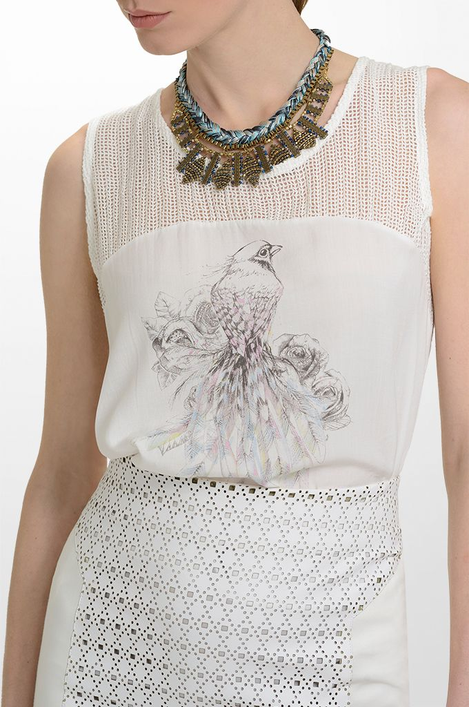 Sarah Lawrence - sleeveless printed top with combination of two fabrics, laser cut pencil skirt with combination of two fabrics, necklace.