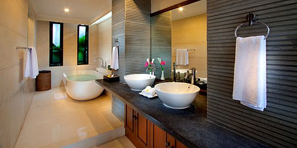 Exotic modern bathroom...close to my dream bathroom...minus the black tiles