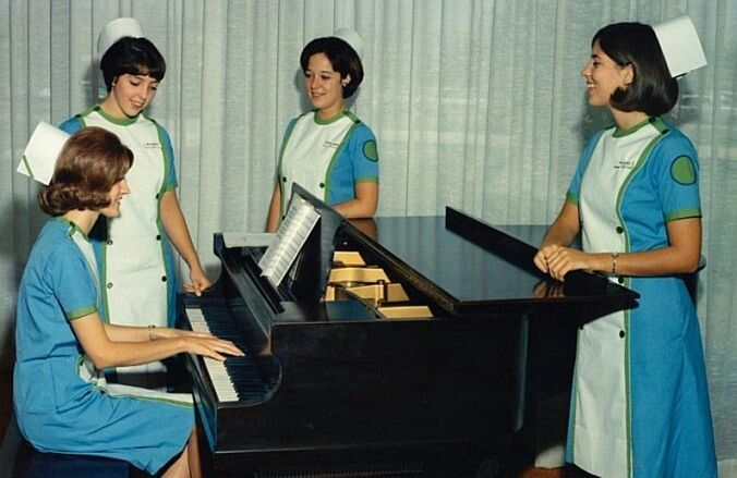 1969 Medical College of Virginia (MCV) Student Nurses - what an unusual combination of uniform colors!  There certainly couldn't have been ANY possible confusion about who was who on their units! Nursing students at the left of the piano show a corner stripe of that green color on their caps, likely making them Sophomore/Junior level students. Depending of course on how their nursing school ran their program. The others may have them as well, but they can't be seen.