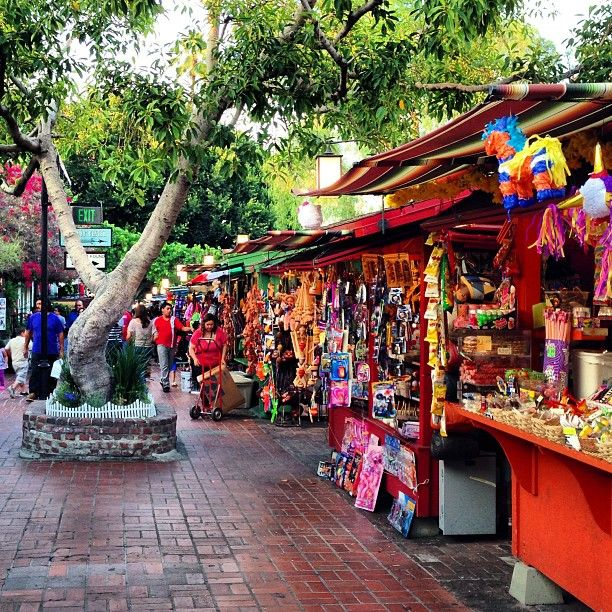Olvera Street in Los Angeles, CA  Visitors can shop, listen to mariachi music, watch folkloric dances and dine at several authentic Mexican restaurants.