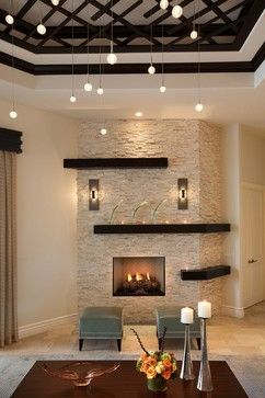 Fireplace with stone surround and stained wood mantel. I like pendants if stone went wall to wall (far enough apart)