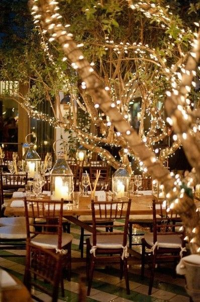 Light your trees with mini lights to give your wedding a beautiful glow…